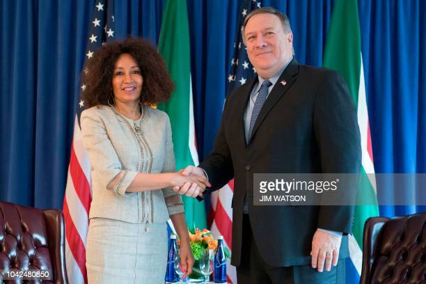 Secretary of State Mike Pompeo shakes hands with South African Foreign Minister Lindiwe Sisulu in New York on September 28, 2018.