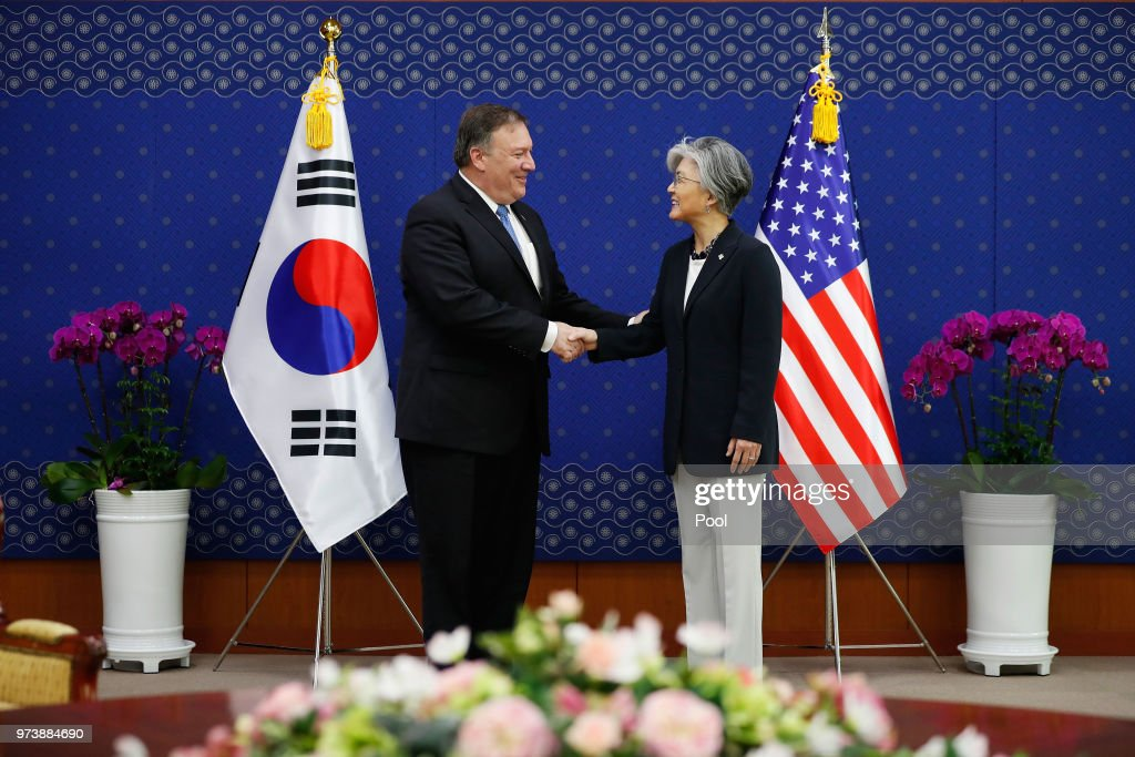 U.S. Secretary of State Mike Pompeo shakes hands with South Korean Foreign Minister Kang Kyung-wha during their meeting at foreign ministry on June 14, 2018 in Seoul, South Korea. U.S. Secretary of State Mike Pompeo visited South Korea to meet South Korea's President Moon Jae-in and Japan's Foreign Minister following a landmark meeting between U.S. President Donald Trump and North Korean leader Kim Jong-un.