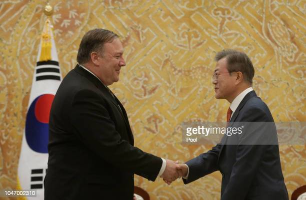 S Secretary of State Mike Pompeo shakes hands with South Korean President Moon Jaein before their meeting at presidential blue house on October 7...