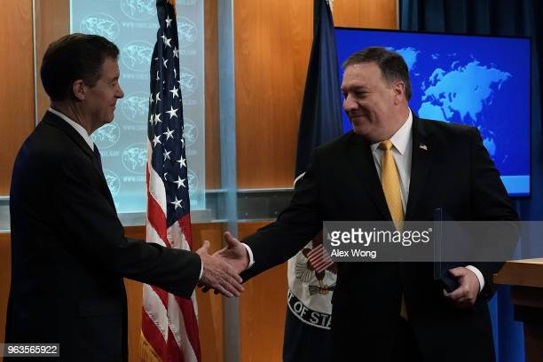 S Secretary of State Mike Pompeo shakes hands with State Department Ambassador at Large for International Religious Freedom Sam Brownback during a...