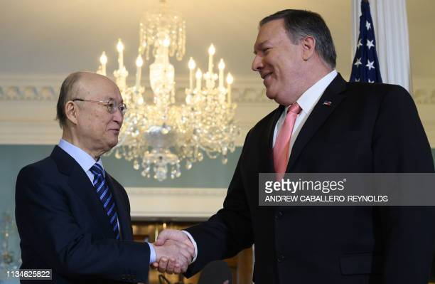 Secretary of State Mike Pompeo shakes hands with the Director General of the International Atomic Energy Agency Yukiya Amano at the US Department of...
