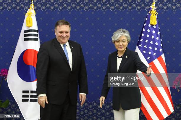 S Secretary of State Mike Pompeo shakes with South Korean Foreign Minister Kang Kyungwha during their meeting at foreign ministry on June 14 2018 in...