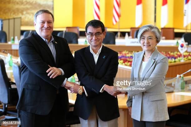 US Secretary of State Mike Pompeo South Korean Foreign Minister Kang Kyungwha and Japanese Foreign Minister Taro Kono pose for photographs during the...
