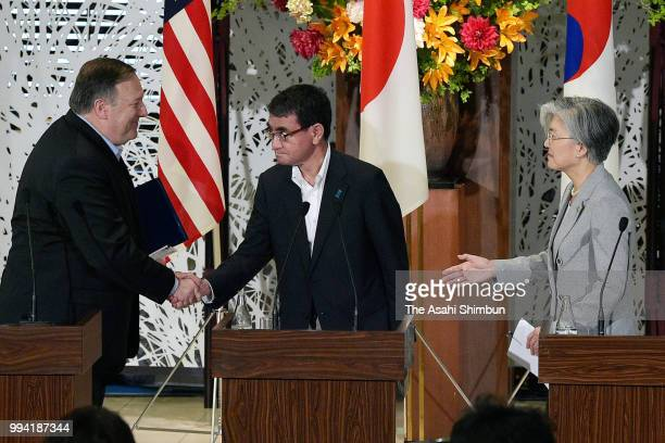 US Secretary of State Mike Pompeo South Korean Foreign Minister Kang Kyungwha and Japanese Foreign Minister Taro Kono shake hands after a joint press...