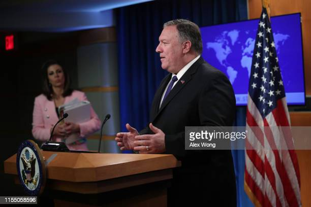 S Secretary of State Mike Pompeo speaks as spokesperson Morgan Ortagus listens during a media briefing at the State Department June 10 2019 in...