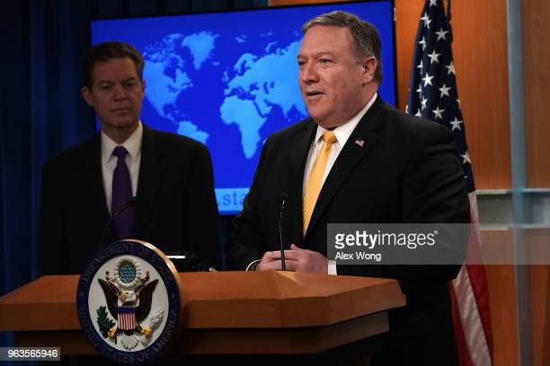 S Secretary of State Mike Pompeo speaks as State Department Ambassador at Large for International Religious Freedom Sam Brownback listens during a...