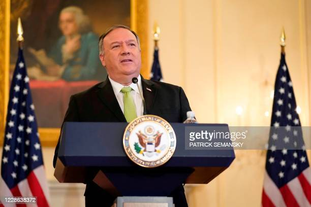Secretary of State Mike Pompeo speaks during a news conference to announce the Trump administration's restoration of sanctions on Iran, on September...
