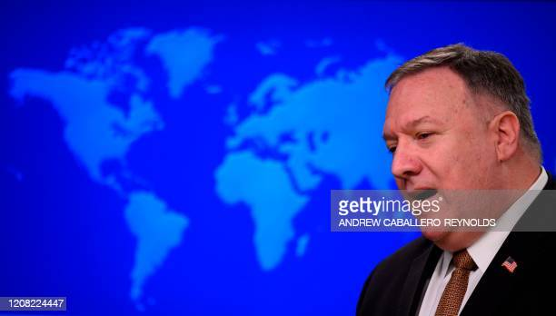 Secretary of State Mike Pompeo speaks during a press conference at the State Department in Washington, DC, on March 25, 2020. - Foreign ministers of...