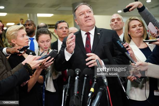 US Secretary of State Mike Pompeo speaks to reporters at the US Capitol after briefing senators in Washington DC on November 28 2018 US Secretary of...