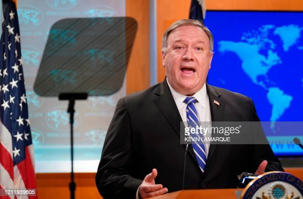 Secretary of State Mike Pompeo speaks to reporters during a media briefing at the State Department in Washington, DC, May 6, 2020. - The United...