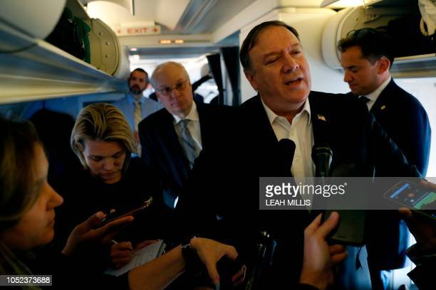 US Secretary of State Mike Pompeo speaks to reporters while his plane refuels in Brussels Belgium on October 17 2018 Secretary of State Mike Pompeo...