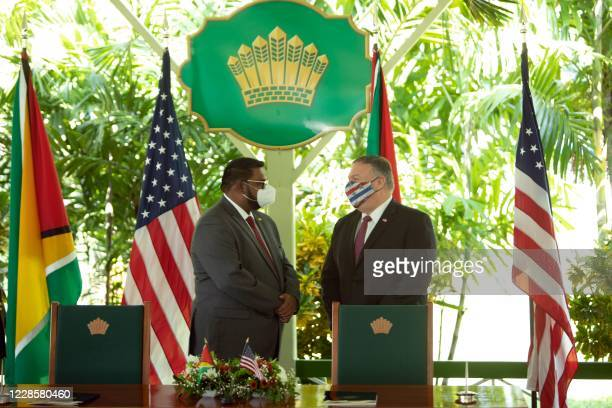 US Secretary of State Mike Pompeo speaks with Guyana's President Mohamed Irfaan Ali during a joint press conference in Georgetown on September 18...