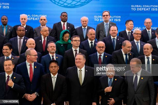 US Secretary of State Mike Pompeo stands alongside foreign ministers and leaders during a family photo at the Meeting of the Ministers of the Global...