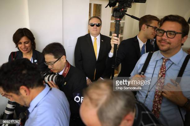 S Secretary of State Mike Pompeo stands among news photographers before the start of a joint news conference with President Donald Trump and Japanese...