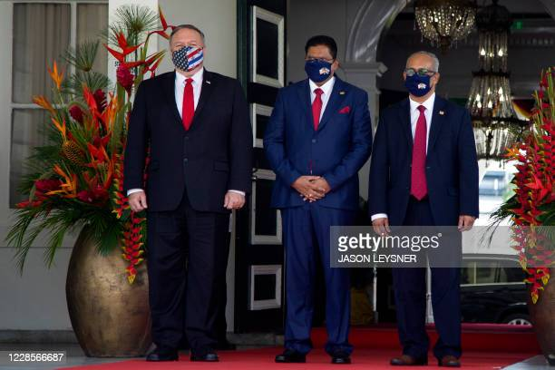 US Secretary of State Mike Pompeo stands next to Surinam's President Chan Santokhi and Surinam's Minister of Foreign Affairs Albert Ramdin at the...