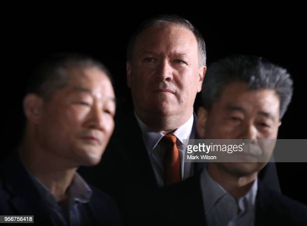 Secretary of State Mike Pompeo stands with two Americans just released from North Korea Kim Dong Chul Kim Haksong and Tony Kim at Joint Base Andrews...