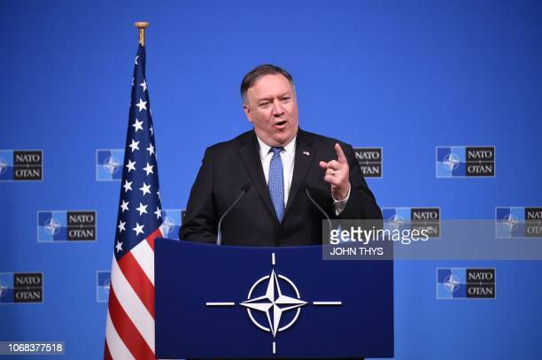 Secretary of State, Mike Pompeo talks during a press conference after a NATO Foreign Ministers meeting at the NATO headquarters in Brussels on...