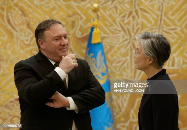 US Secretary of State Mike Pompeo talks with South Korean Foreign Minister Kang Kyungwha before a meeting with South Korean President Moon Jaein at...