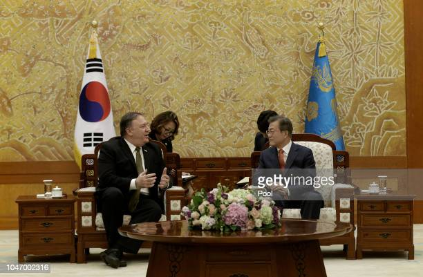 S Secretary of State Mike Pompeo talks with South Korean President Moon Jaein during their meeting at presidential blue house on October 7 2018 in...