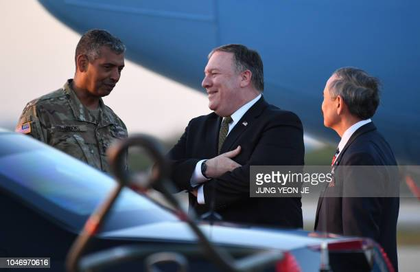 US Secretary of State Mike Pompeo talks with US ambassador to South Korea Harry Harris and US General Vincent K Brooks commander of United States...