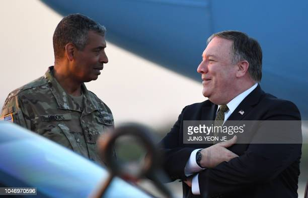 US Secretary of State Mike Pompeo talks with US General Vincent K Brooks commander of United States Forces Korea upon his arrival at Osan Air Base in...