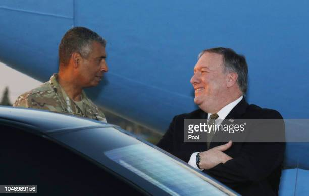 S Secretary of State Mike Pompeo talks with US General Vincent K Brooks commander of United States Forces Korea upon his arrival at Osan Air Base in...