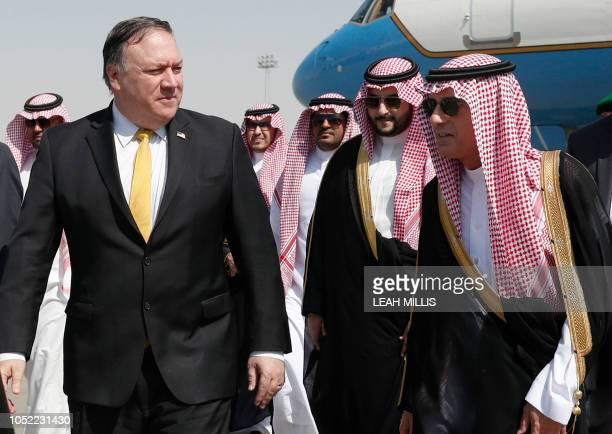 US Secretary of State Mike Pompeo walks alongside Saudi Foreign Minister Adel alJubeir after arriving in Riyadh on October 16 2018 Pompeo arrived in...