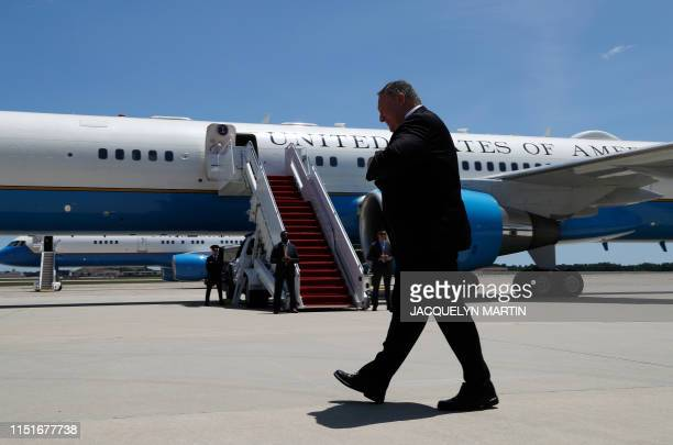 US Secretary of State Mike Pompeo walks by the media as he prepares to board a plane headed to Jeddah Saudi Arabia at Andrews Air Force Base near...