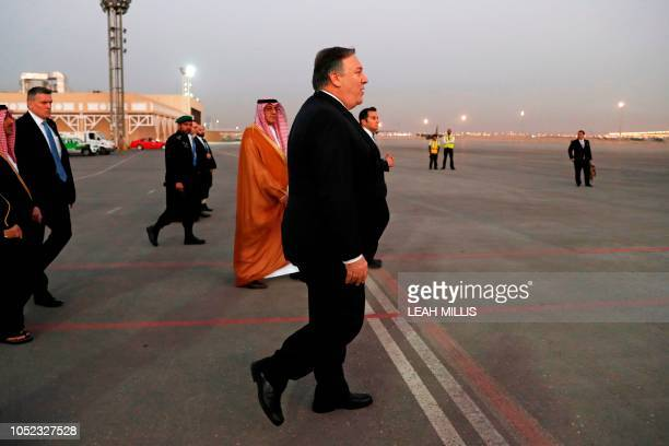 US Secretary of State Mike Pompeo walks to the plane before leaving Riyadh Saudi Arabia on October 17 2018 US President Donald Trump pushed back...