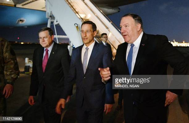 US Secretary of State Mike Pompeo walks with Acting Assistant Secretary for Near Eastern Affairs at the State Department David Satterfield and Charge...