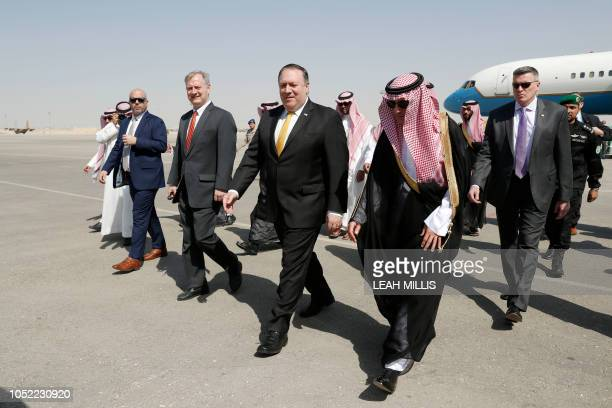 US Secretary of State Mike Pompeo walks with Saudi Foreign Minister Adel alJubeir after arriving in Riyadh on October 16 2018