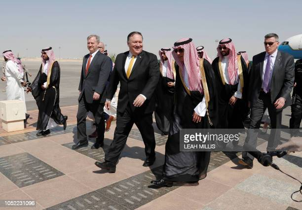 US Secretary of State Mike Pompeo walks with Saudi Foreign Minister Adel alJubeir after arriving in Riyadh on October 16 2018 Pompeo arrived in the...