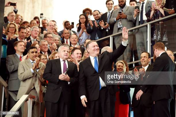 S Secretary of State Mike Pompeo waves at department employees and officials during a welcome ceremony in the lobby of the Harry S Truman Building...