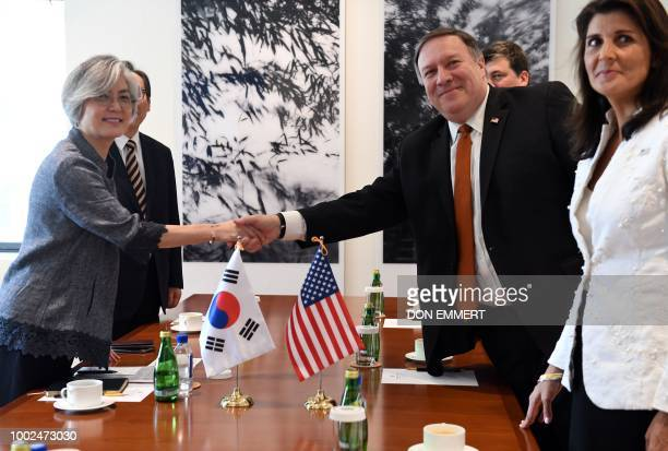 US Secretary of State Mike Pompeo with US Ambassador to the UN Nikki Haley shakes hand with South Korean Foreign Minister Kang Kyungwha before a...