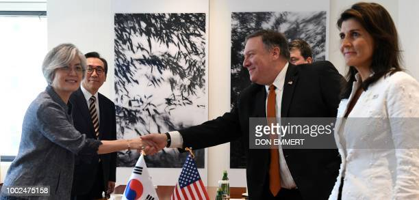 US Secretary of State Mike Pompeo with US Ambassador to the UN Nikki Haley and South Korean Ambassador to the UN Cho Taeyul shakes hand with South...