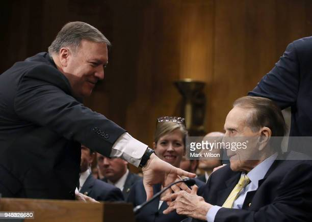 Secretary of State nominee Mike Pompeo thanks former Senate Majority Leader Bob Dole for his comments during his confirmation hearing before a Senate...