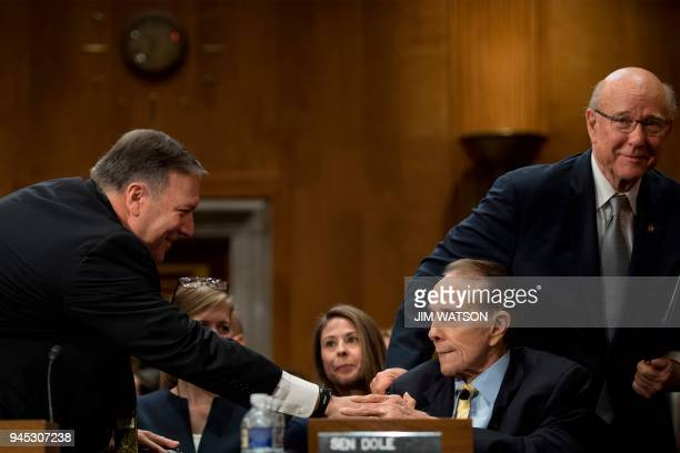 US Secretary of State nominee Mike Pompeo thanks former US Senator Bob Dole RKansas and US Senator Pat Roberts RKansas for their introductions as he...