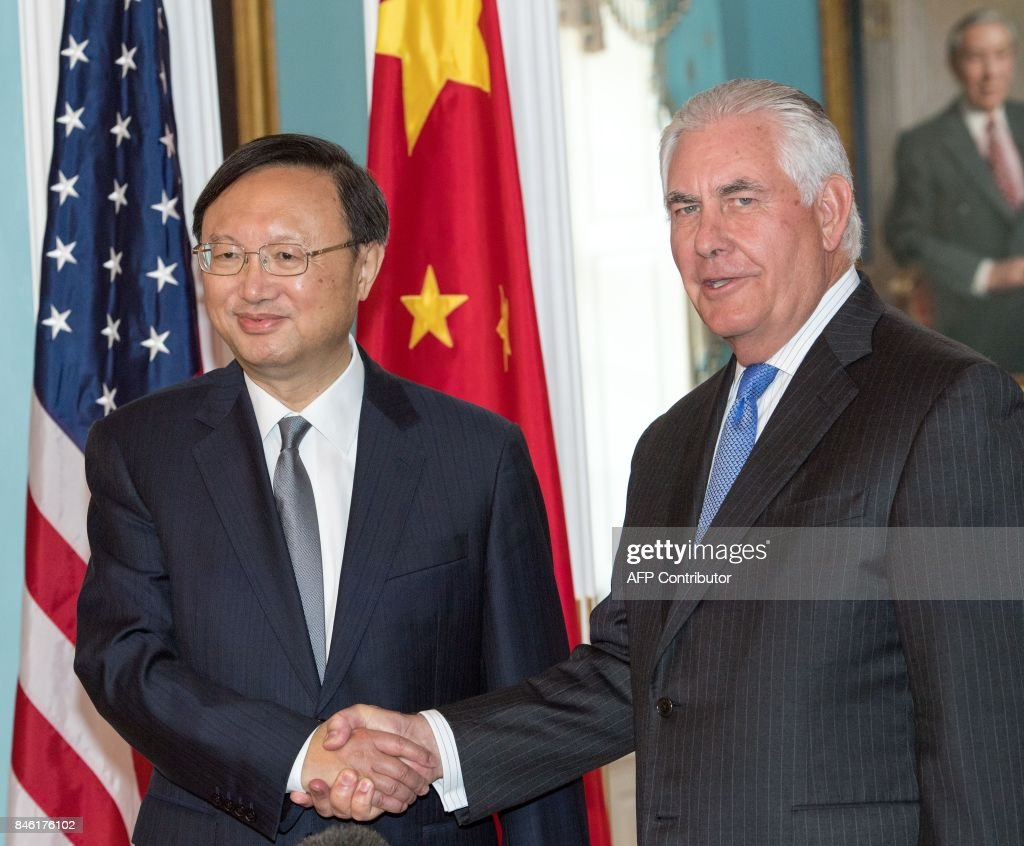 US Secretary of State Rex Tillerson(R) and Chinese State Councilor Yang Jiechi shake hands before their private meeting at the US Department of State September 12, 2017, in Washington, DC. /