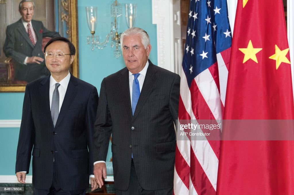 US Secretary of State Rex Tillerson(R) and Chinese State Councilor Yang Jiechi walk together towards the Treaty Room for a photo opportunity before their private meeting at at the US Department of State September 12, 2017, in Washington, DC. /