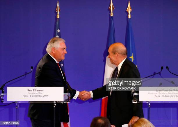 US Secretary of State Rex Tillerson and French Minister for Europe and Foreign Affairs JeanYves Le Drian shake hands during a press conference on...