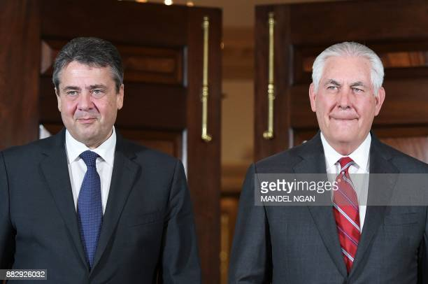 US Secretary of State Rex Tillerson and Germany's Foreign Minister Sigmar Gabriel arrive to pose for photos ahead of a bilateral at the State...