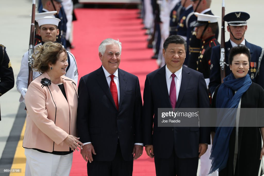 U.S. Secretary of State Rex Tillerson and his wife Renda St. Clair greet Chinese President Xi Jinping and first lady Peng Liyuan after they arrived at Palm Beach International Airport April 6, 2017 in West Palm Beach, Florida. President Xi is in Florida to meet with President Donald Trump to discuss a range of sensitive issues including trade and North Korea at Trump's Mar-a-Lago retreat.