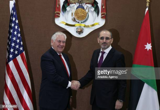 Secretary of State Rex Tillerson and Jordanian Foreign Minister Ayman Al Safadi shake hands as they pose for a photo during their meeting in Amman...