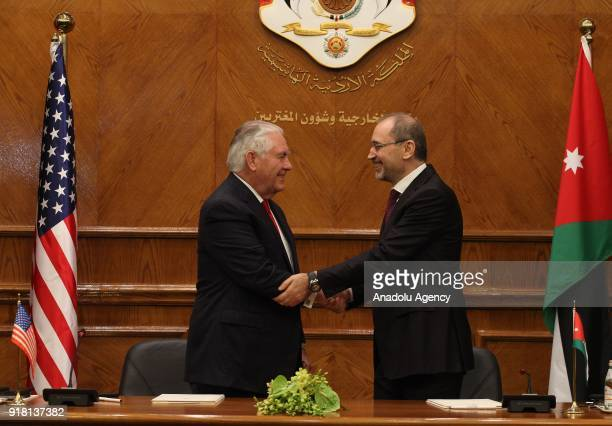 Secretary of State Rex Tillerson and Jordanian Foreign Minister Ayman Al Safadi shake their hands after they signed a memorandum of understanding as...