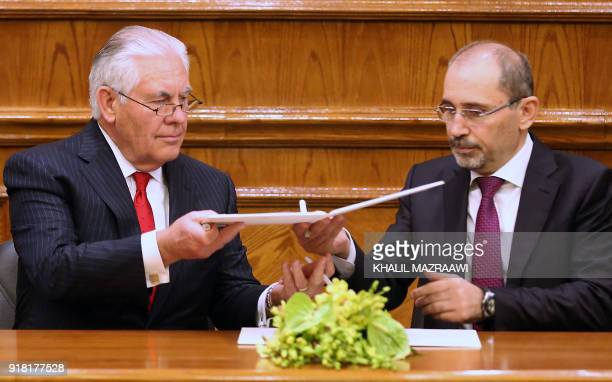 US Secretary of State Rex Tillerson and Jordanian Foreign Minister Ayman Safadi sign an agreement in Amman on February 14 2018 The United States is...