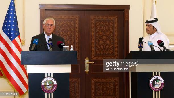 US Secretary of State Rex Tillerson and Qatari Foreign Minister Sheikh Mohammed bin Abdulrahman AlThani listen to questions by journalists during a...