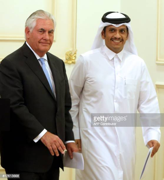 US Secretary of State Rex Tillerson and Qatari Foreign Minister Sheikh Mohammed bin Abdulrahman AlThani leave the stage following a press conference...