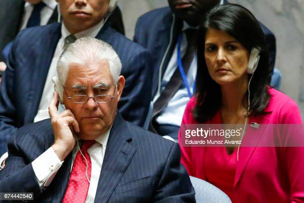 Secretary of State Rex Tillerson and US Ambassador to the UN Nikki Haley listen as China's Foreign Minister Wang Yi speaks during a security council...