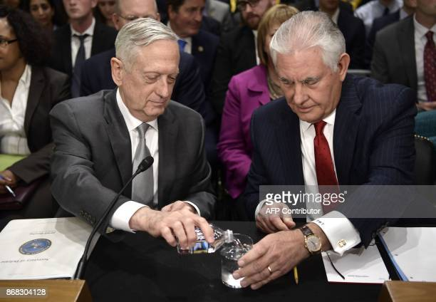 US Secretary of State Rex Tillerson and US Defense Secretary James Mattis arrive to testify at a full committee hearing on 'The Authorizations for...