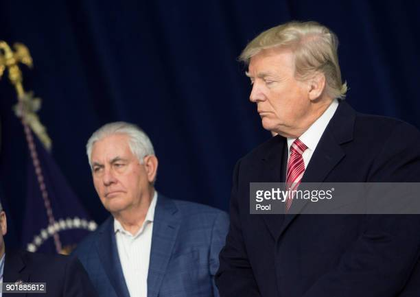 US Secretary of State Rex Tillerson and US President Donald Trump listen as Republicans take turns speaking to the media at Camp David on January 6...